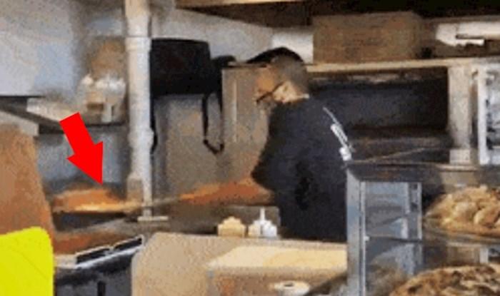 Netko je snimio bizarni način na koji je živčani radnik pripremao pizzu za dostavu