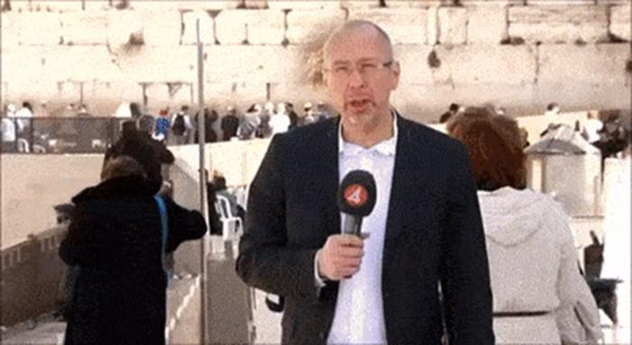 TV reporter je snimao ozbiljan prilog, a onda se pojavila žena koja mu je slučajno ukrala show