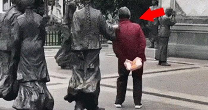 Smijat ćete se kad vidite zbog čega se ova osoba zapravo zaustavila kraj kipova