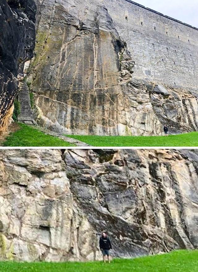 Zidine Königstein dvorca su ogromne. Jedan lik se slikao ispred njih kako bi usporedio veličinu.