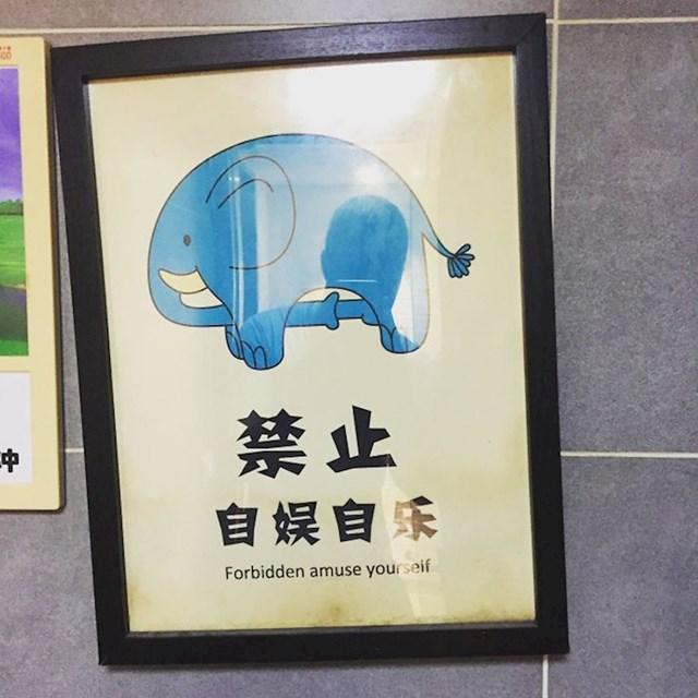 Kineski restoran ima pomalo neprimjerenu sliku na ulazu u WC.