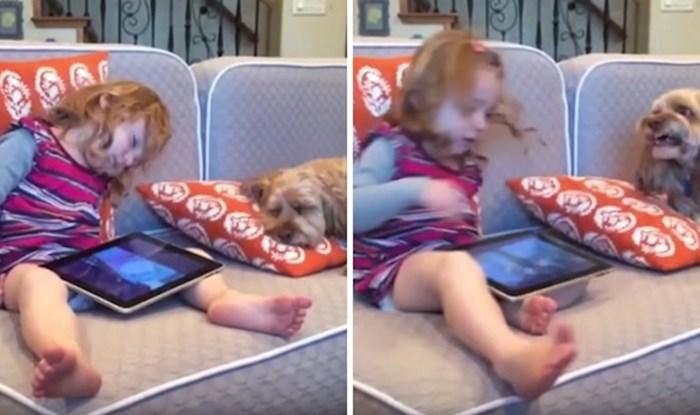 VIDEO Mala djevojčica je zaspala s tabletom u krilu, probudila ju je reakcija psa koji je odmah reagirao