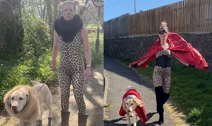 Žena šeće psa obučena u luckaste kostime kako bi oraspoložila susjede zbog situacije s koronavirusom