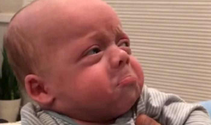 Tata je ogrebao bebicu bradom dok ju je ljubio, njeni izrazi lica su neprocjenjivi