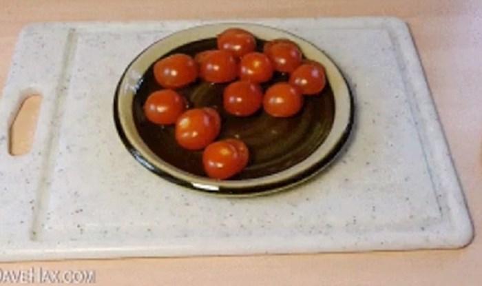 Ovaj kratki video pokazat će vam kako prerezati cherry rajčice bez prljanja kuhinje