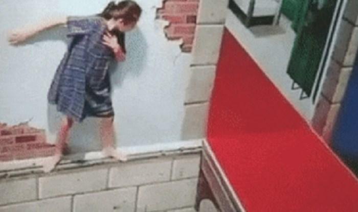 Izgleda kao da žena hoda uz rub zgrade, kraj će vas iznenaditi